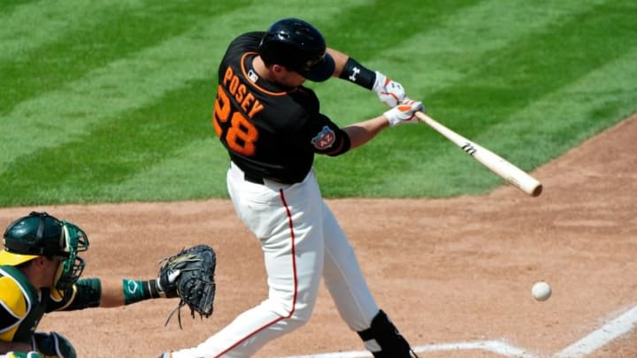 Mar 21, 2016; Scottsdale, AZ, USA; San Francisco Giants catcher Buster Posey (28) grounds out in the third inning against the Oakland Athletics at Scottsdale Stadium. Mandatory Credit: Matt Kartozian-USA TODAY Sports