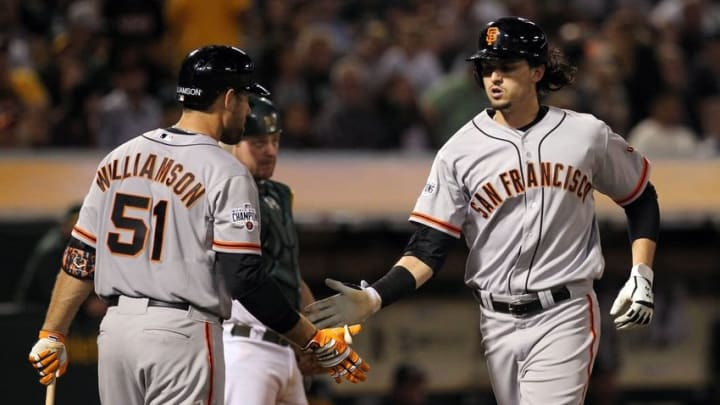 Sep 25, 2015; Oakland, CA, USA; San Francisco Giants right fielder Mac Williamson (51) greets center fielder Jarrett Parker (47) after his solo home run against the Oakland Athletics in the seventh inning of their MLB baseball game at O.co Coliseum. Mandatory Credit: Lance Iversen-USA TODAY Sports