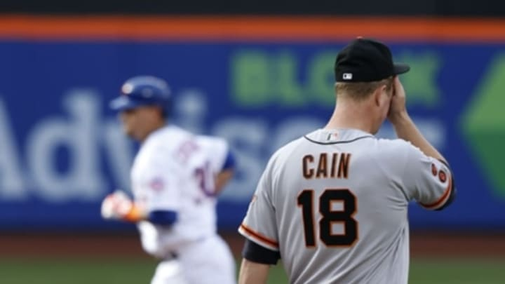 Apr 30, 2016; New York City, NY, USA; San Francisco Giants starting pitcher Matt Cain (18) reacts after giving up a home run to New York Mets left fielder Michael Conforto (30) in the fifth inning at Citi Field. Mandatory Credit: Noah K. Murray-USA TODAY Sports