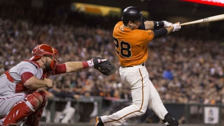 Jun 24, 2016; San Francisco, CA, USA; San Francisco Giants catcher Buster Posey (28) singles on a line drive to Philadelphia Phillies center fielder Odubel Herrera (not pictured) in the seventh inning at AT&T Park. Mandatory Credit: Neville E. Guard-USA TODAY Sports