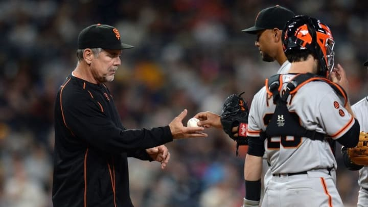 Jul 16, 2016; San Diego, CA, USA; San Francisco Giants manager Bruce Bochy (left) relieves starting pitcher Albert Suarez (56) during the seventh inning against the San Diego Padres at Petco Park. Mandatory Credit: Jake Roth-USA TODAY Sports
