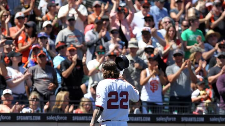 Jul 4, 2016; San Francisco, CA, USA; San Francisco Giants starting pitcher Jake Peavy (22) tips his hat as he receives a standing ovation after being retired in the seventh inning of their MLB baseball game with the Colorado Rockies at AT&T Park. Mandatory Credit: Lance Iversen-USA TODAY Sports