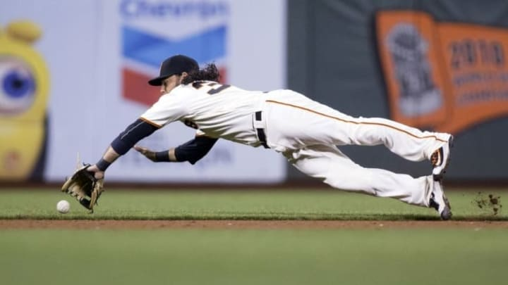 Aug 15, 2016; San Francisco, CA, USA; San Francisco Giants shortstop Brandon Crawford (35) dives for a ground ball single hit by Pittsburgh Pirates first baseman David Freese (not pictured) at AT&T Park the Pittsburgh Pirates defeated the San Francisco Giants 8 to 5. Mandatory Credit: Neville E. Guard-USA TODAY Sports