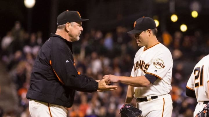 Sep 27, 2016; San Francisco, CA, USA; San Francisco Giants manager Bruce Bochy (15) relieves starting pitcher Matt Moore (45) during the game against the Colorado Rockies in the eighth inning at AT&T Park. Mandatory Credit: John Hefti-USA TODAY Sports