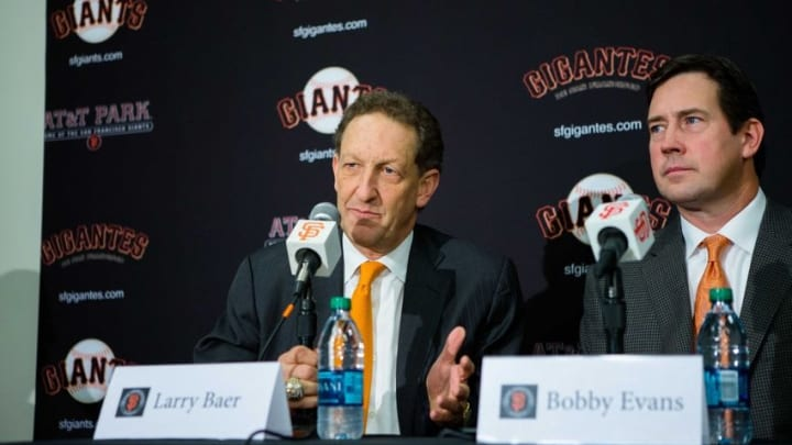 Dec 17, 2015; San Francisco, CA, USA; San Francisco Giants chief executive officer Larry Baer and senior vice president and general manager Bobby Evans announce the signing of pitcher Johnny Cueto at a press conference at AT&T Park. Mandatory Credit: John Hefti-USA TODAY Sports