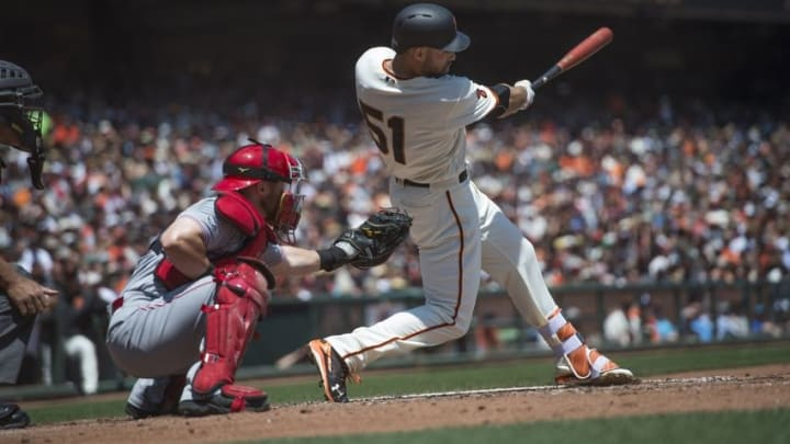 Jul 27, 2016; San Francisco, CA, USA; San Francisco Giants right fielder Mac Williamson (51) hits the ball during the fourth inning against the Cincinnati Reds at AT&T Park. Mandatory Credit: Kenny Karst-USA TODAY Sports