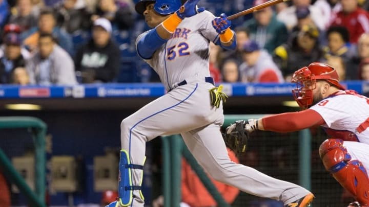 Sep 30, 2016; Philadelphia, PA, USA; New York Mets left fielder Yoenis Cespedes (52) hits a single in front of Philadelphia Phillies catcher Cameron Rupp (29) during the fourth inning at Citizens Bank Park. Mandatory Credit: Bill Streicher-USA TODAY Sports