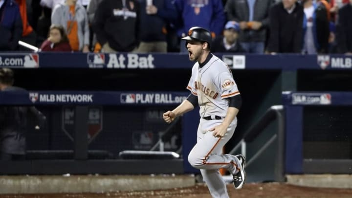 Oct 5, 2016; New York City, NY, USA; San Francisco Giants third baseman Conor Gillaspie (21) reacts after hitting a three run home run during the ninth inning against the New York Mets in the National League wild card playoff baseball game at Citi Field. Mandatory Credit: Anthony Gruppuso-USA TODAY Sports