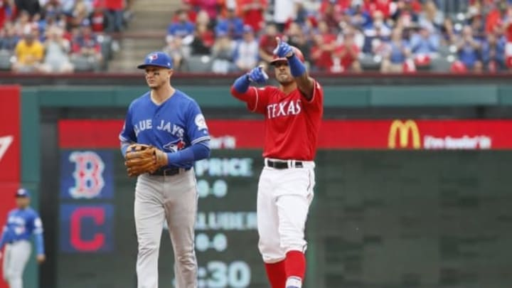 Oct 7, 2016; Arlington, TX, USA; Texas Rangers center fielder Ian Desmond (20) reacts after a double against the Toronto Blue Jays during the seventh inning of game two of the 2016 ALDS playoff baseball series at Globe Life Park in Arlington. Mandatory Credit: Tim Heitman-USA TODAY Sports