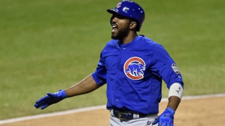 Nov 2, 2016; Cleveland, OH, USA; Chicago Cubs center fielder Dexter Fowler (24) celebrates after hitting a solo home run against the Cleveland Indians in the first inning in game seven of the 2016 World Series at Progressive Field. Mandatory Credit: David Richard-USA TODAY Sports