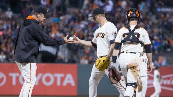 Jun 13, 2016; San Francisco, CA, USA; San Francisco Giants manager Bruce Bochy (15) pulls starting pitcher Matt Cain (18) in the top of the fourth inning against the Milwaukee Brewers at AT&T Park. Mandatory Credit: Neville E. Guard-USA TODAY Sports