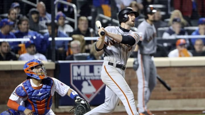 Oct 5, 2016; New York City, NY, USA; San Francisco Giants third baseman Conor Gillaspie (21) hits a three run home run during the ninth inning against the New York Mets in the National League wild card playoff baseball game at Citi Field. Mandatory Credit: Anthony Gruppuso-USA TODAY Sports