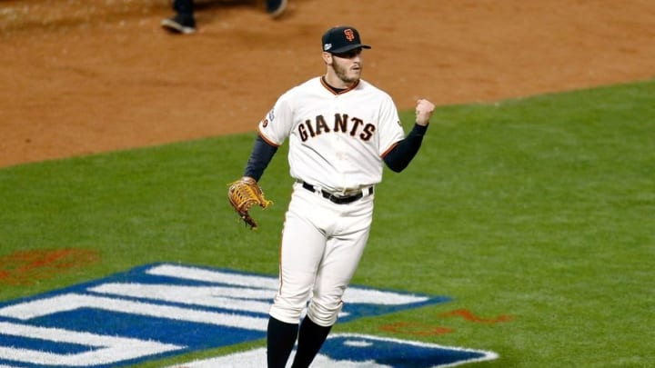 Oct 10, 2016; San Francisco, CA, USA; San Francisco Giants relief pitcher Ty Blach (50) reacts after Chicago Cubs catcher David Ross (not pictured) grounded into a double play to end the thirteenth inning during game three of the 2016 NLDS playoff baseball series at AT&T Park. Mandatory Credit: John Hefti-USA TODAY Sports
