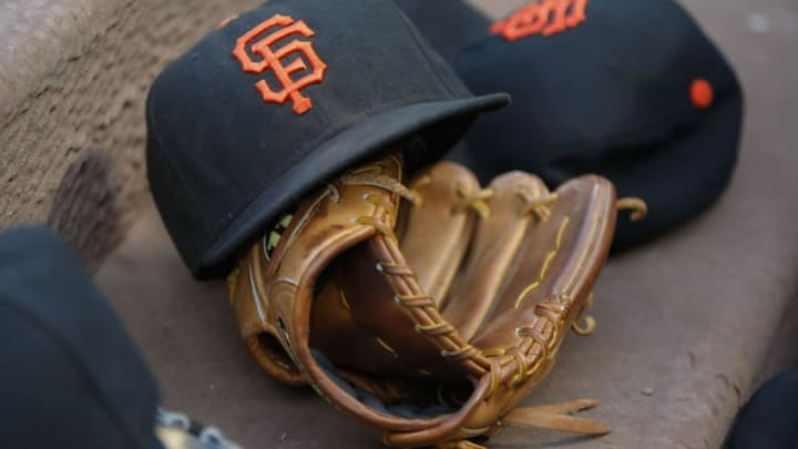 Aug 4, 2015; Atlanta, GA, USA; General view of a San Francisco Giants hat and glove in the dugout against the Atlanta Braves in the third inning at Turner Field. Mandatory Credit: Brett Davis-USA TODAY Sports