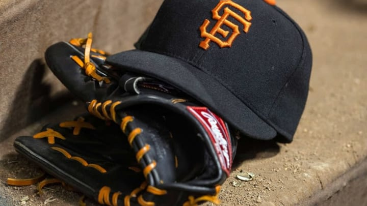 Jul 31, 2015; Arlington, TX, USA; A view of a San Francisco Giants baseball hat and glove during the game between the Texas Rangers and the San Francisco Giants at Globe Life Park in Arlington. The Rangers defeated the Giants 6-3. Mandatory Credit: Jerome Miron-USA TODAY Sports