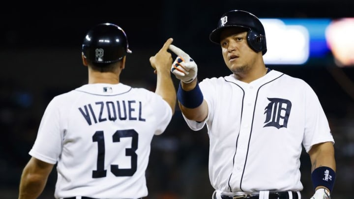 Jun 20, 2016; Detroit, MI, USA; Detroit Tigers first baseman Miguel Cabrera (24) receives congratulations from first base coach Omar Vizquel (13) after he hits a single in the ninth inning against the Seattle Mariners at Comerica Park. Mandatory Credit: Rick Osentoski-USA TODAY Sports