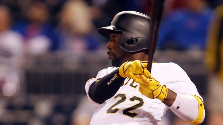 Sep 27, 2016; Pittsburgh, PA, USA; Pittsburgh Pirates center fielder Andrew McCutchen (22) hits a two run single against the Chicago Cubs during the ninth inning at PNC Park. The Cubs won 6-4. Mandatory Credit: Charles LeClaire-USA TODAY Sports
