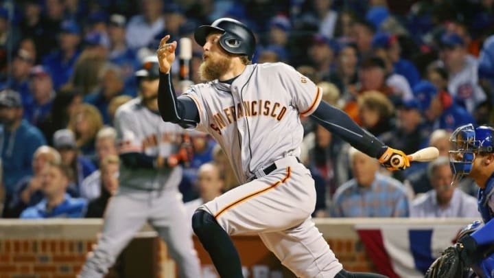 Oct 8, 2016; Chicago, IL, USA; San Francisco Giants right fielder Hunter Pence (8) hits a single against the Chicago Cubs during the second inning during game two of the 2016 NLDS playoff baseball series at Wrigley Field. Mandatory Credit: Jerry Lai-USA TODAY Sports