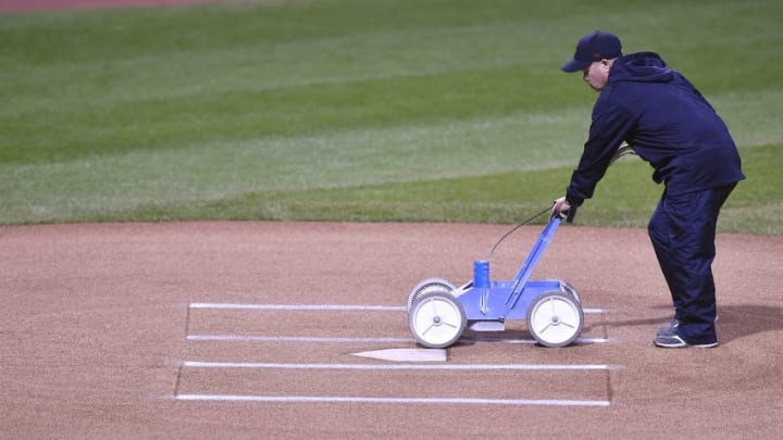 Oct 14, 2016; Cleveland, OH, USA; A member of the grounds crew prepares the home plate area prior to game one of the 2016 ALCS playoff baseball series between the Cleveland Indians and the Toronto Blue Jays at Progressive Field. Mandatory Credit: David Richard-USA TODAY Sports