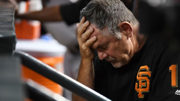 PHOENIX, AZ - AUGUST 05: Manager Bruce Bochy #15 of the San Francisco Giants rests his head in his hand while sitting in the dugout during the third inning of a game against the Arizona Diamondbacks at Chase Field on August 5, 2018 in Phoenix, Arizona. (Photo by Norm Hall/Getty Images)