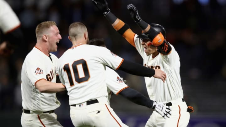 SAN FRANCISCO, CA - AUGUST 28: Gorkys Hernandez #7 of the San Francisco Giants is congratulated by teammates after he hit a single that scored the game-winning run in the ninth inning against the Arizona Diamondbacks at AT&T Park on August 28, 2018 in San Francisco, California. (Photo by Ezra Shaw/Getty Images)