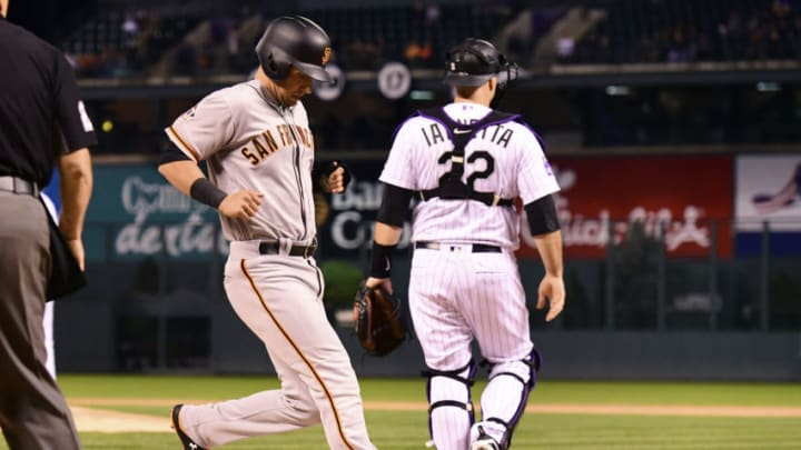 DENVER, CO - SEPTEMBER 5: Joe Panik #12 of the San Francisco Giants scores in the first inning of a baseball game against the Colorado Rockies on September 5, 2018 at Coors Field in Denver, Colorado. (Photo by Julio Aguilar/Getty Images)