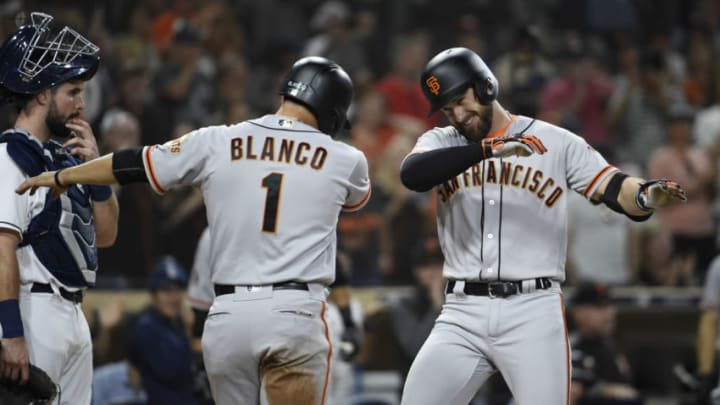 SAN DIEGO, CA - SEPTEMBER 17: Evan Longoria #10 of the San Francisco Giants, right, celebrates with Gregor Blanco #1 after hitting a two-run home run during the fifth inning of a baseball game against the San Diego Padres at PETCO Park on September 17, 2018 in San Diego, California. (Photo by Denis Poroy/Getty Images)