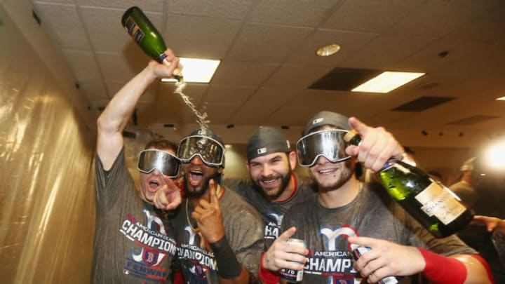 HOUSTON, TX - OCTOBER 18: (L-R) Brock Holt #12; Eduardo Nunez #36, Mitch Moreland #18, and Andrew Benintendi #16 of the Boston Red Sox celebrate in the clubhouse after defeating the Houston Astros 4-1 in Game Five of the American League Championship Series to advance to the 2018 World Series at Minute Maid Park on October 18, 2018 in Houston, Texas. (Photo by Elsa/Getty Images)