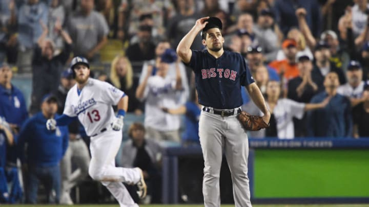 LOS ANGELES, CA - OCTOBER 26: Nathan Eovaldi #17 of the Boston Red Sox watches the ball leave the park as Max Muncy #13 of the Los Angeles Dodgers hits and eighteenth inning walk-off home run to win the game 3-2 in Game Three of the 2018 World Series at Dodger Stadium on October 26, 2018 in Los Angeles, California. (Photo by Kevork Djansezian/Getty Images)