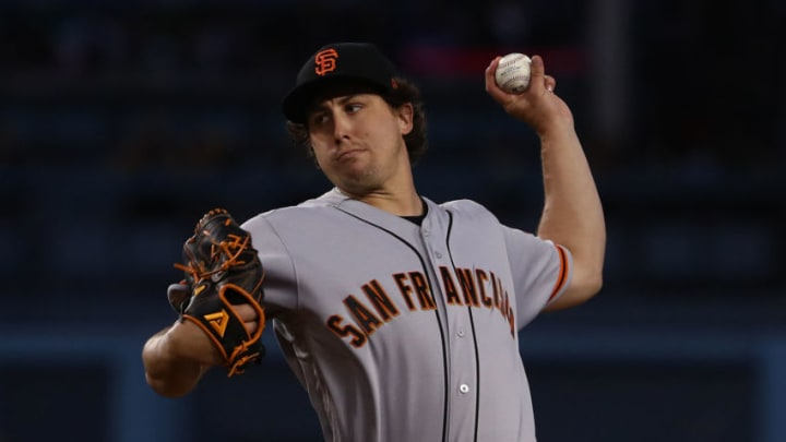 LOS ANGELES, CALIFORNIA - APRIL 03: Pitcher Derek Holland #45 of the San Francisco Giants pitches in the first inning of the MLB game against the Los Angeles Dodgers at Dodger Stadium on April 03, 2019 in Los Angeles, California. (Photo by Victor Decolongon/Getty Images)