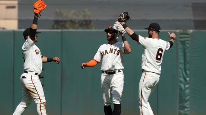 SAN FRANCISCO, CA - APRIL 13: (L-R) Gerardo Parra #8, Kevin Pillar #1 and Steven Duggar #6 of the San Francisco Giants celebrates defeating the Colorado Rockies 5-2 during a Major League Baseball game at Oracle Park on April 13, 2019 in San Francisco, California. (Photo by Thearon W. Henderson/Getty Images)