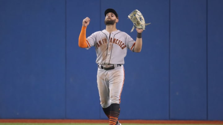 TORONTO, ON - APRIL 23: Kevin Pillar #1 of the San Francisco Giants celebrates their victory during MLB game action against the Toronto Blue Jays Rogers Centre on April 23, 2019 in Toronto, Canada. (Photo by Tom Szczerbowski/Getty Images)