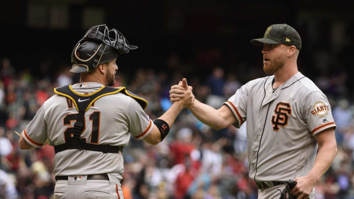 PHOENIX, ARIZONA – MAY 19: Stephen Vogt #21 and Will Smith #13 of the San Francisco Giants celebrate after closing out the tenth inning of the MLB game against the Arizona Diamondbacks at Chase Field on May 19, 2019 in Phoenix, Arizona. The San Francisco Giants won 3-2. (Photo by Jennifer Stewart/Getty Images)