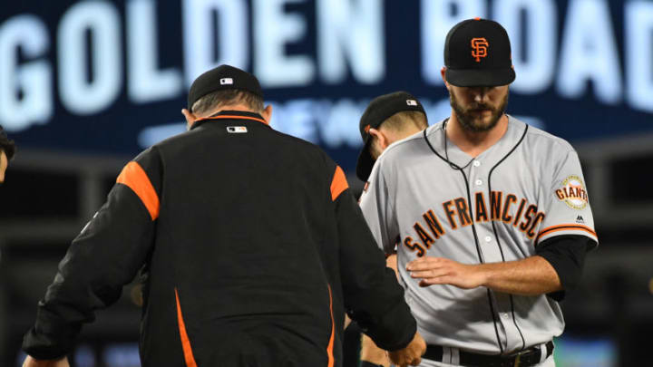 LOS ANGELES, CA - JUNE 19: Manager Bruce Bochy #15 walks to the mound to pull starting pitcher Drew Pomeranz #37 of the San Francisco Giants from the fifth inning of the game against the Los Angeles Dodgers at Dodger Stadium on June 19, 2019 in Los Angeles, California. (Photo by Jayne Kamin-Oncea/Getty Images)