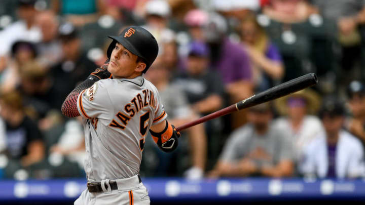 DENVER, CO - JULY 17: Mike Yastrzemski #5 of the San Francisco Giants watches the flight of a fifth inning double against the Colorado Rockies at Coors Field on July 17, 2019 in Denver, Colorado. (Photo by Dustin Bradford/Getty Images)