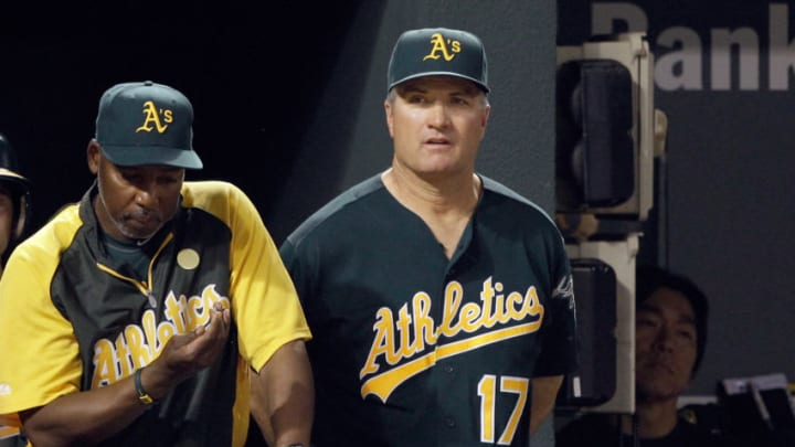 BALTIMORE, MD - JUNE 08: Manager Bob Geren #17 of the Oakland Athletics in the dugout with hitting coach Gerald Perry #39 (L) during the ninth inning of the Athletics loss to the Baltimore Orioles at Oriole Park at Camden Yards on June 8, 2011 in Baltimore, Maryland. (Photo by Rob Carr/Getty Images)
