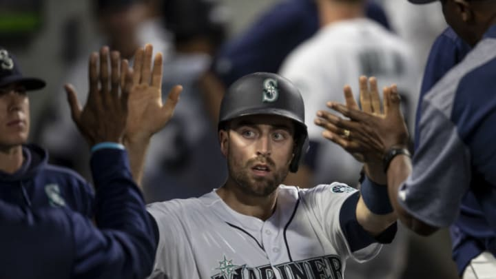 SEATTLE, WA - AUGUST 9: Tom Murphy #2 of the Seattle Mariners is congratulated by teammates in the dugout after scoring a run on a hit by Ryan Court #12 of the Seattle Mariners off of starting pitcher Jalen Beeks #68 of the Tampa Bay Rays during the fourth inning of a game at T-Mobile Park on August 9, 2019 in Seattle, Washington. (Photo by Stephen Brashear/Getty Images)