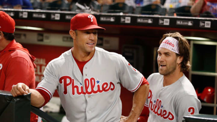 PHOENIX, ARIZONA - AUGUST 06: Manager Gabe Kapler #19 of the Philadelphia Phillies talks with Bryce Harper #3 during the first inning of the MLB game against the Arizona Diamondbacks at Chase Field on August 06, 2019 in Phoenix, Arizona. (Photo by Christian Petersen/Getty Images)