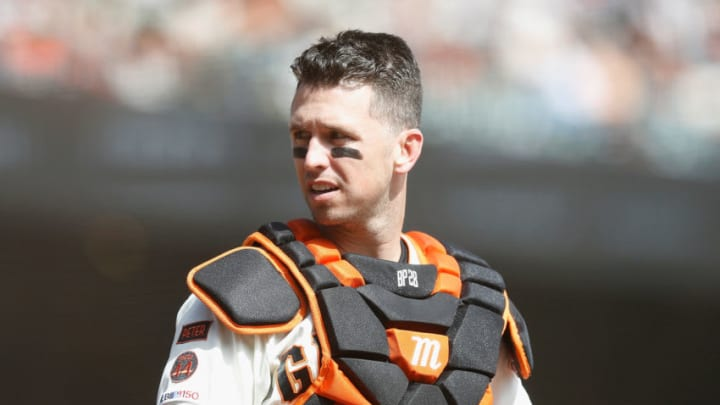 SF Giants catcher Buster Posey will return to the starting lineup in 2021, but who will be joining him on the roster? (Photo by Lachlan Cunningham/Getty Images)