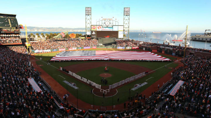 SAN FRANCISCO, CA - OCTOBER 14: An American flag is presented during pre-game ceremonies for Game One of the National League Championship Series between the San Francisco Giants and the St. Louis Cardinals at AT&T Park on October 14, 2012 in San Francisco, California. (Photo by Christian Petersen/Getty Images)