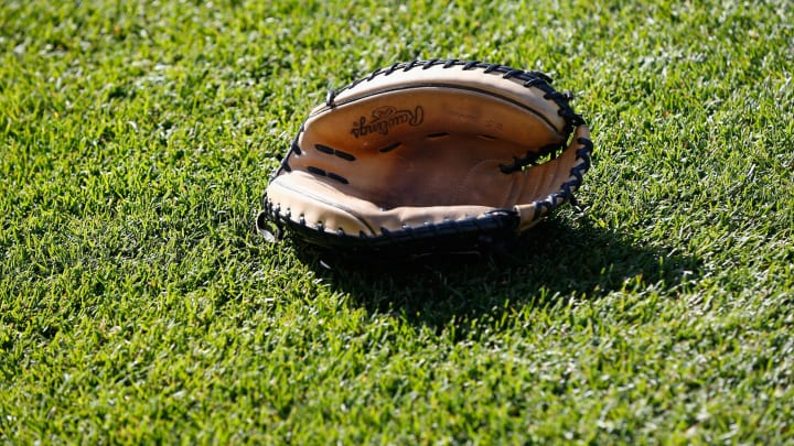 BALTIMORE, MD – APRIL 20: A catcher's mitt sits on the grass before the start of the Toronto Blue Jays and Baltimore Orioles game at Oriole Park at Camden Yards on April 20, 2016 in Baltimore, Maryland. (Photo by Rob Carr/Getty Images)