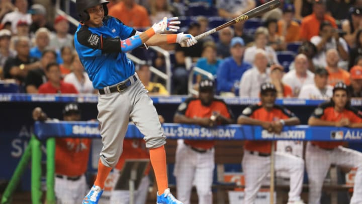 MIAMI, FL - JULY 09: Mauricio Dubon #15 of the Milwaukee Brewers and the World Team swings at a pitch against the U.S. Team during the SiriusXM All-Star Futures Game at Marlins Park on July 9, 2017 in Miami, Florida. (Photo by Mike Ehrmann/Getty Images)