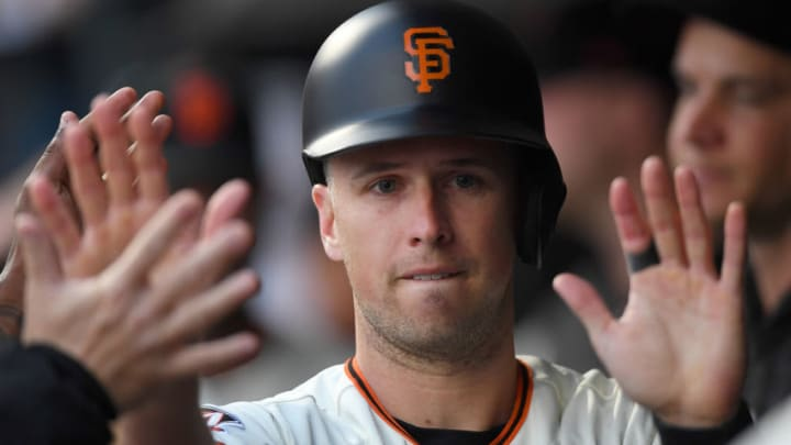 SAN FRANCISCO, CA - MAY 14: Buster Posey #28 of the San Francisco Giants is congratulated by teammates after he scored on a Brandon Crawford two-run rbi double against the Cincinnati Reds in the bottom of the first inning at AT&T Park on May 14, 2018 in San Francisco, California. (Photo by Thearon W. Henderson/Getty Images)