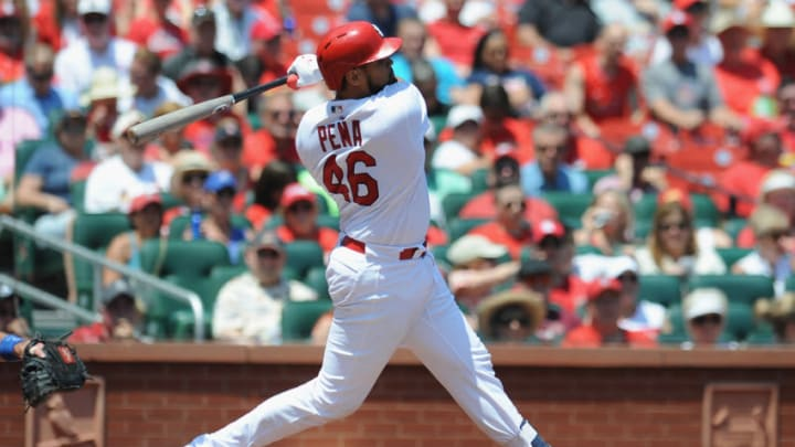 ST. LOUIS, MO - MAY 23: Francisco Pena #46 of the St. Louis Cardinals hits a RBI double in the second inning against the Kansas City Royals at Busch Stadium on May 23, 2018 in St. Louis, Missouri. (Photo by Michael B. Thomas /Getty Images)