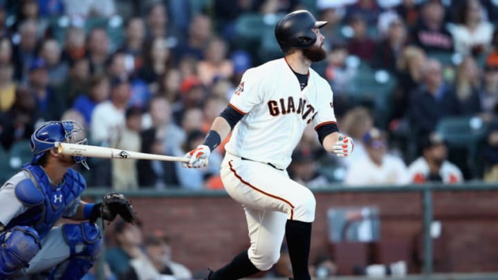 SAN FRANCISCO, CA - JULY 10: Brandon Belt #9 of the San Francisco Giants bats against the Chicago Cubs in the first inning at AT&T Park on July 10, 2018 in San Francisco, California. (Photo by Ezra Shaw/Getty Images)