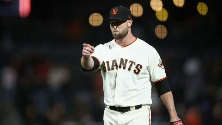 SAN FRANCISCO, CA - AUGUST 27: Hunter Strickland #60 of the San Francisco Giants points to catcher Nick Hundley #5 after they beat the Arizona Diamondbacks at AT&T Park on August 27, 2018 in San Francisco, California. (Photo by Ezra Shaw/Getty Images)