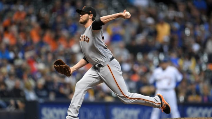 MILWAUKEE, WI - SEPTEMBER 07: Steven Okert #32 of the San Francisco Giants throws a pitch during the eighth inning of a game against the Milwaukee Brewers at Miller Park on September 7, 2018 in Milwaukee, Wisconsin. (Photo by Stacy Revere/Getty Images)