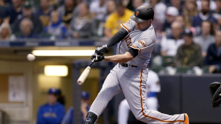 MILWAUKEE, WI - SEPTEMBER 08: Ryder Jones #14 of the San Francisco Giants hits a home run in the eighth inning against the Milwaukee Brewers at Miller Park on September 8, 2018 in Milwaukee, Wisconsin. (Photo by Dylan Buell/Getty Images)