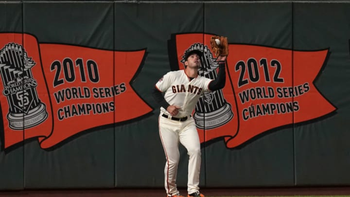 SAN FRANCISCO, CA - SEPTEMBER 26: Chris Shaw #26 of the San Francisco Giants catches a fly ball against the San Diego Padres in the top of the first inning at AT&T Park on September 26, 2018 in San Francisco, California. (Photo by Thearon W. Henderson/Getty Images)