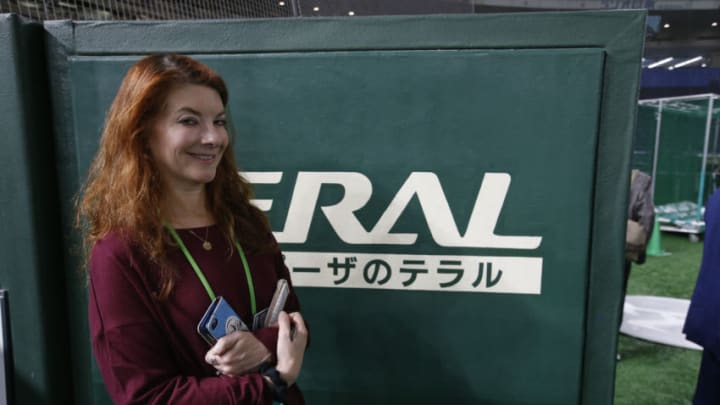 TOKYO, JAPAN - MARCH 21: Reporter Susan Slusser of the San Francisco Chronicle stands on the field prior to the game between the Oakland Athletics and the Seattle Mariners at the Tokyo Dome on March 21, 2019 in Tokyo, Japan. The Mariners defeated the Athletics 5-4. (Photo by Michael Zagaris/Oakland Athletics/Getty Images)